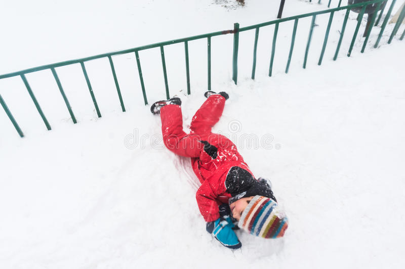 Download Rolling on snow stock image. Image of playing, childhood - 37121505