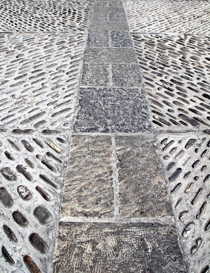 Rolling stones mosaic medieval soil floor Spain stock photo