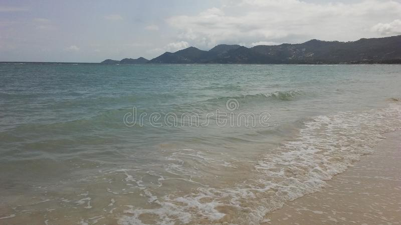 Rolling Waves at Chaweng Beach on Koh Samui Island, Thailand. Rolling Waves at Chaweng Beach on Koh Samui Island in Thailand stock image