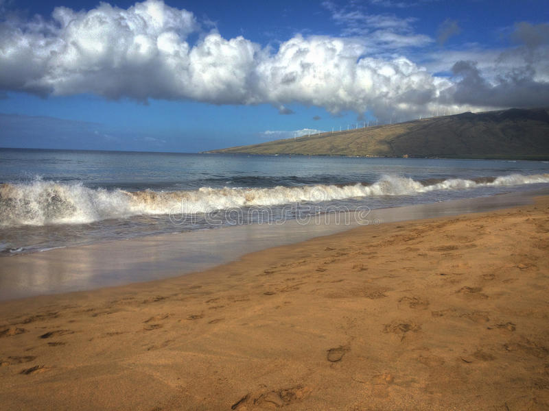 Rolling waves of Maui. Rolling waves ready to crash and beautiful clouds at Kenolio Beach Park on Maui royalty free stock photography