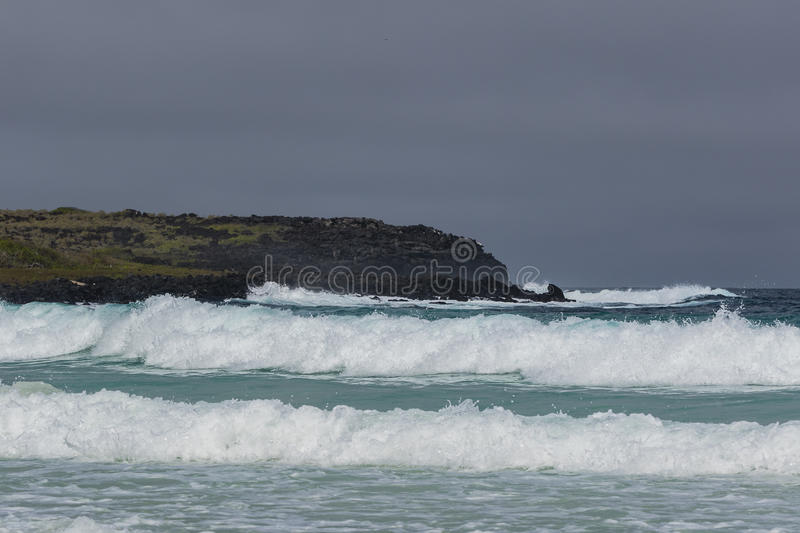 Rolling waves in the ocean. At San Cristobal, Galapagos stock image