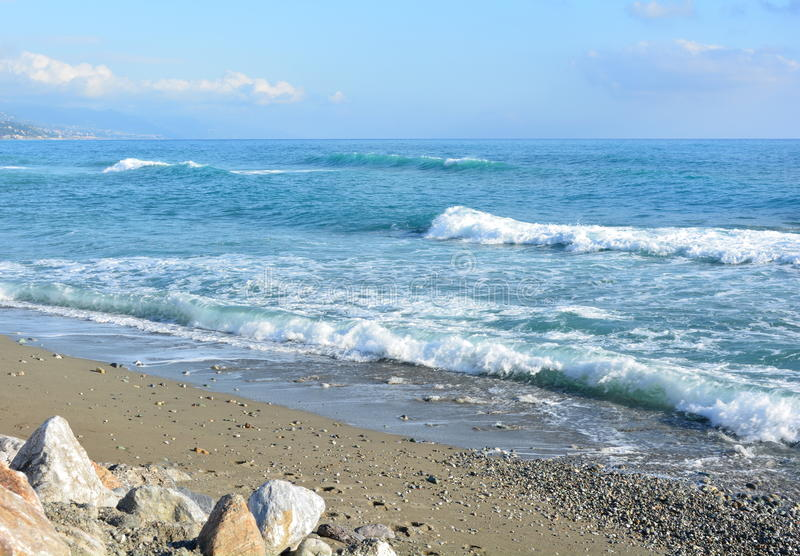 Rolling waves. Onto a beach stock photography