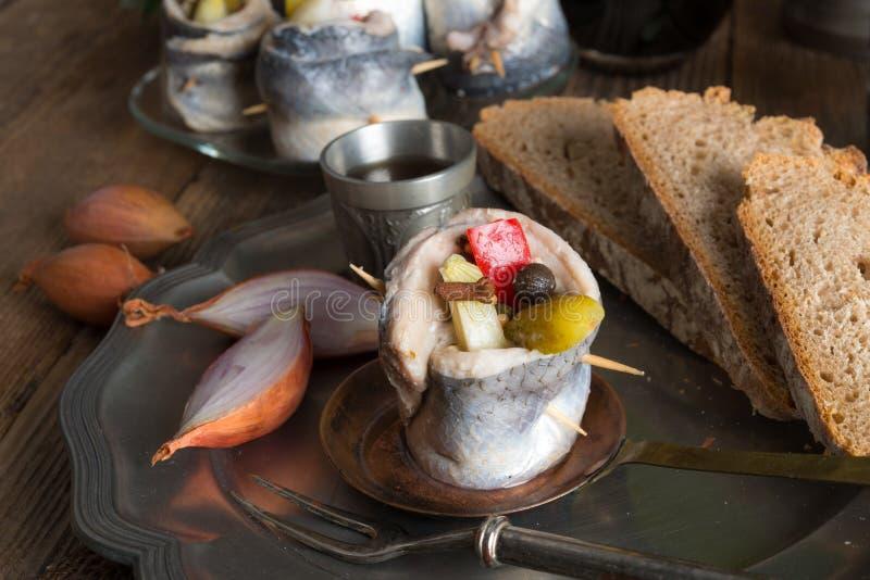 Rollmops - filets de harengs marinés photo stock