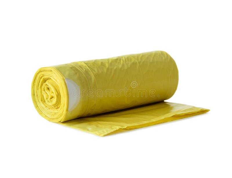 Rollo de los bolsos de basura amarillos imágenes de archivo libres de regalías