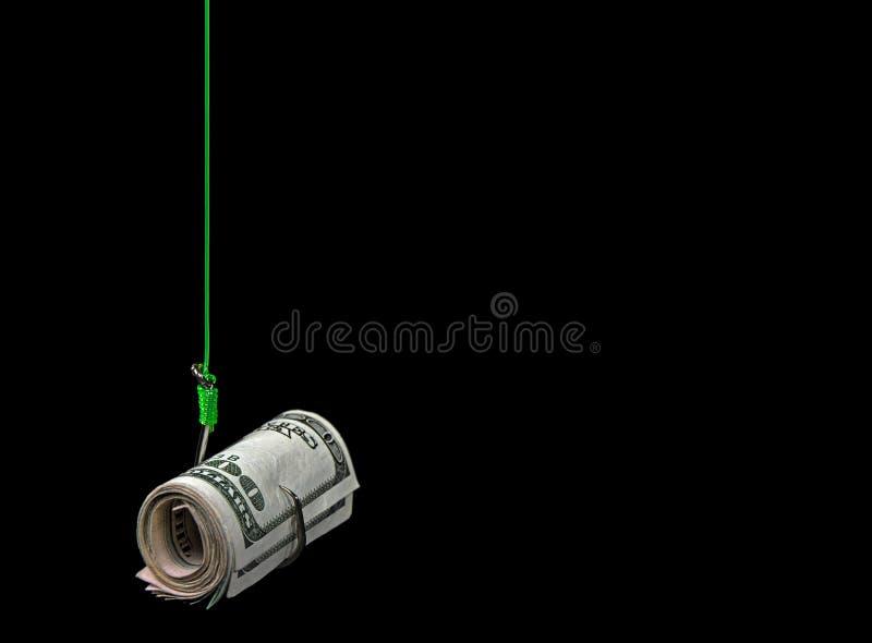 Rollo del dinero en el gancho de pescados imagen de archivo