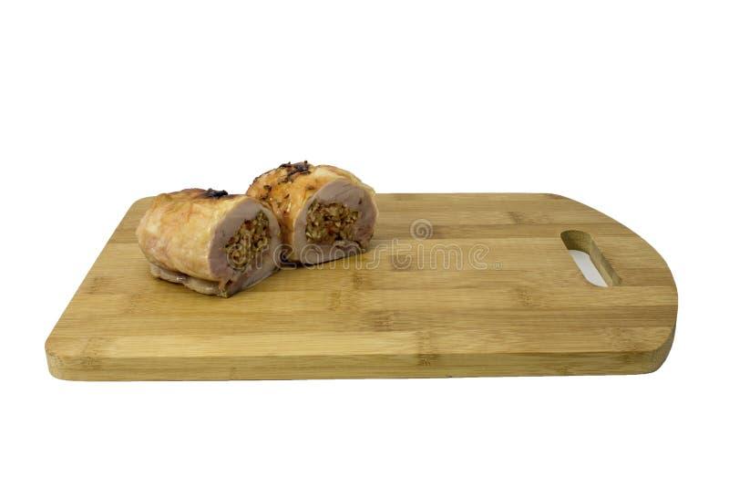 Rollo del pollo con las setas en una tabla de cortar fotografía de archivo libre de regalías