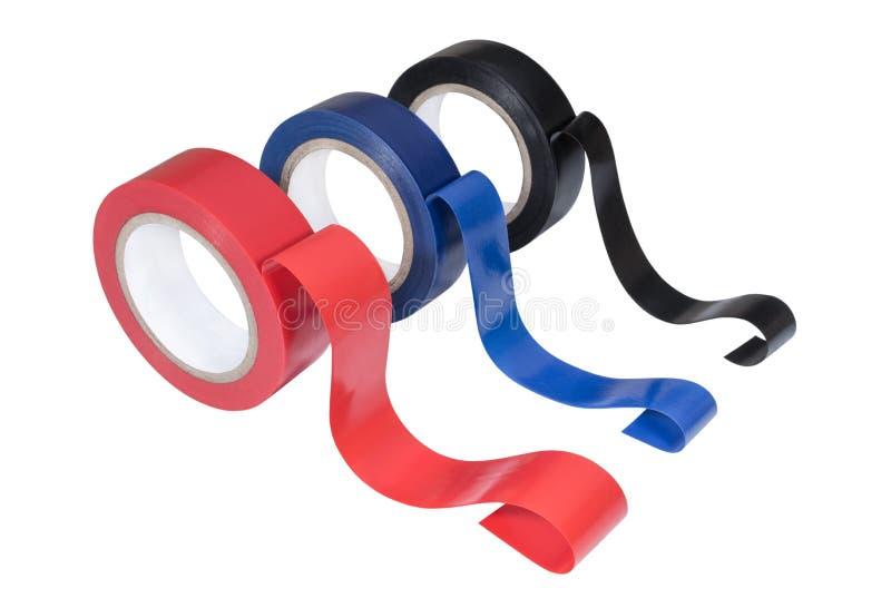 Rollos coloreados de la cinta eléctrica del aislamiento foto de archivo