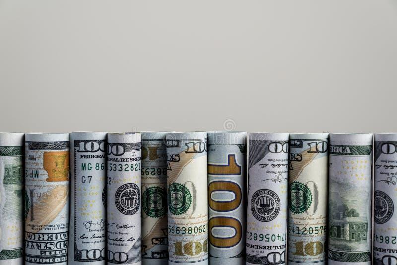 Rollos de billetes en dólares estadounidenses consecutivos foto de archivo libre de regalías