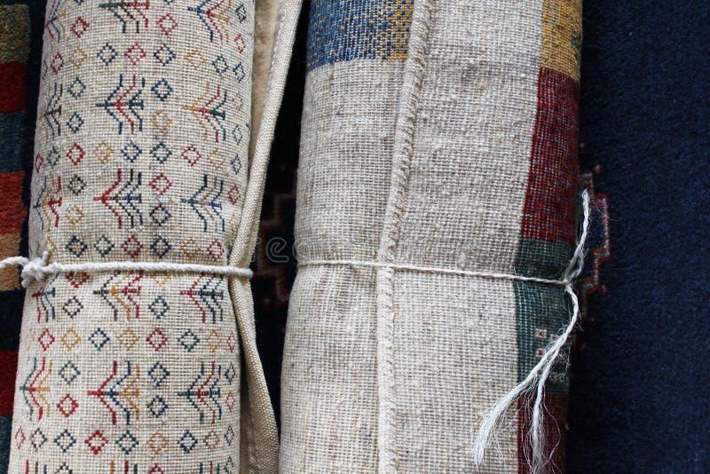 Rolls или перские ковры стоковые фотографии rf