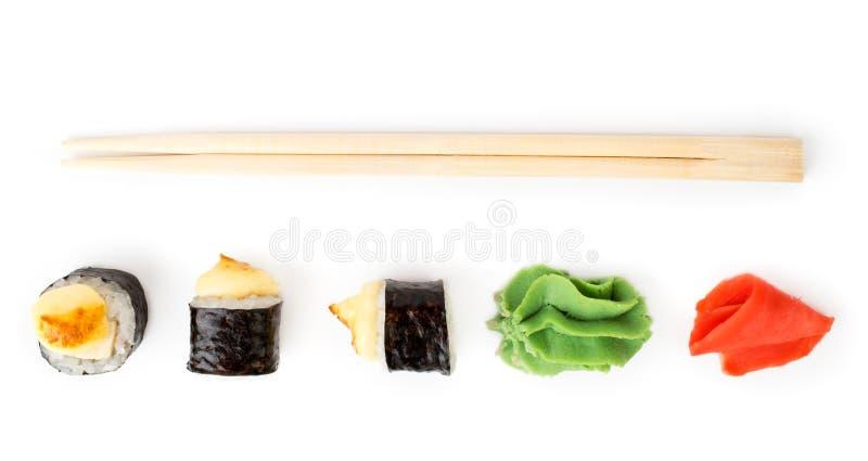 Rolls, имбирь, wasabi, палочки для суш, взгляд от верхней части стоковое фото