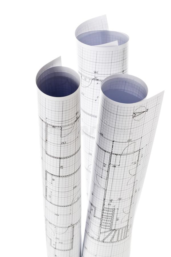 Rolls of architectural blueprint house building plans isolated on white. Background stock photos