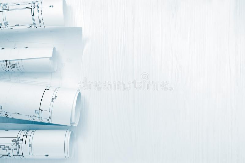 Rolls of architectural blueprints and project plans on architect royalty free stock image