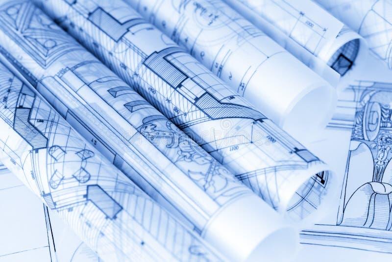 Rolls of architecture blueprints stock photo