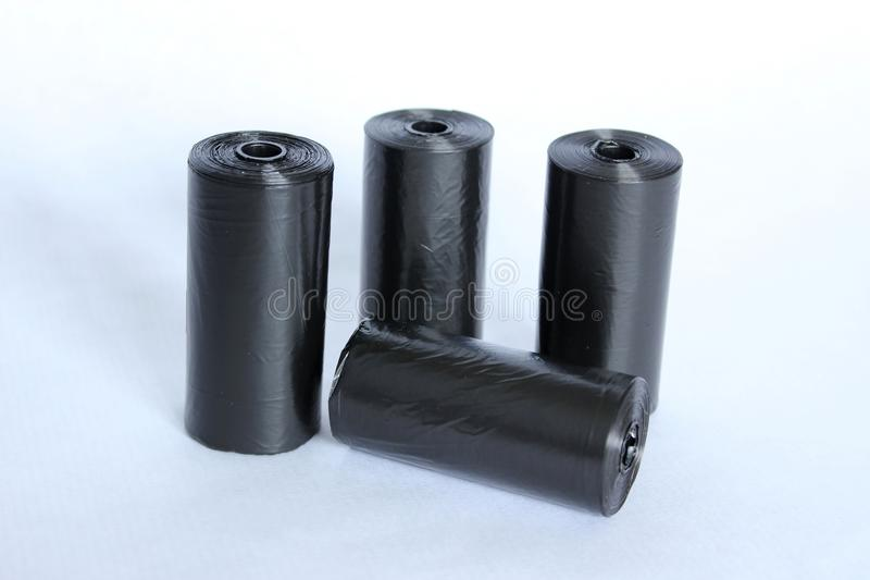Rolls of black pouch for collecting canine droppings royalty free stock photo