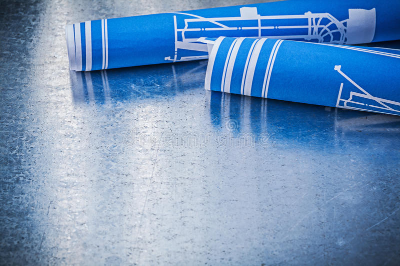 Rolls of blue construction drawings on metallic background build download rolls of blue construction drawings on metallic background build stock image image of maintenance malvernweather Image collections