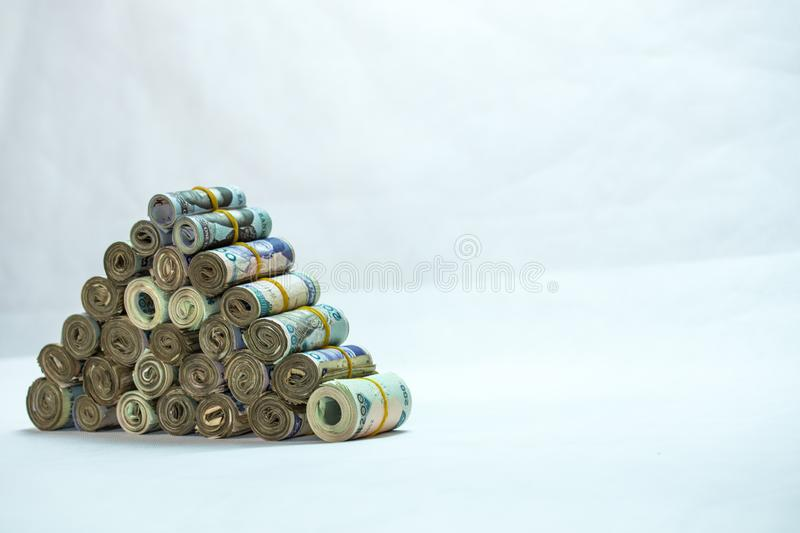 Rolls and Bundles of Naira Cash local currencies in a pyramid heap stock photo