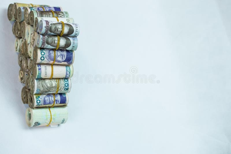 Rolls and Bundles of Naira Cash local currencies in a pyramid heap. Rolls and Bundles of Naira Cash local currencies royalty free stock photos