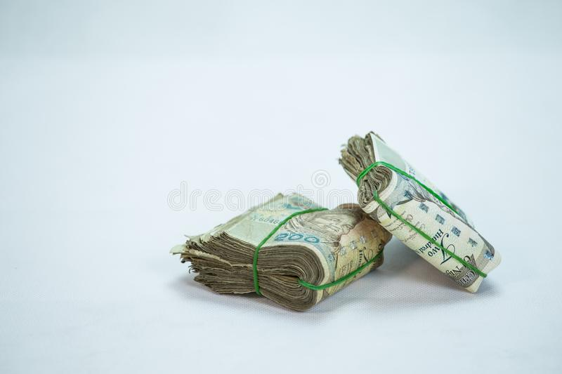 Rolls and Bundles of Naira Cash local currencies in a pyramid heap. Rolls and Bundles of Naira Cash local currencies stock image