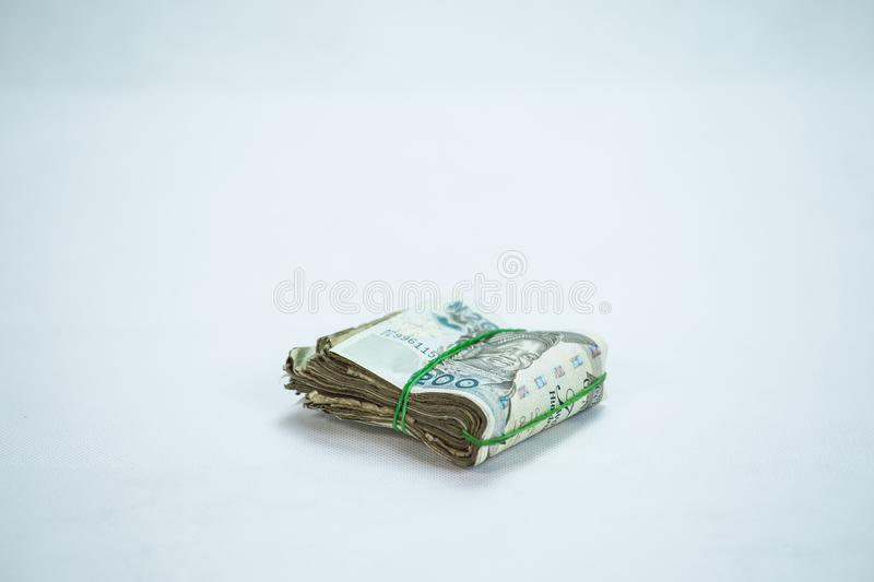 Rolls and Bundles of Naira Cash local currencies in a pyramid heap royalty free stock photo