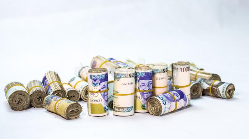 Rolls and Bundles of Naira Cash local currencies in a pyramid heap stock images
