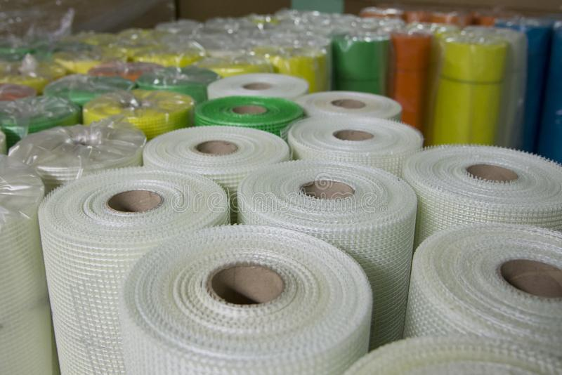 Rolls of colored fiberglass mesh, building materials for wall insulation. Close-up royalty free stock images