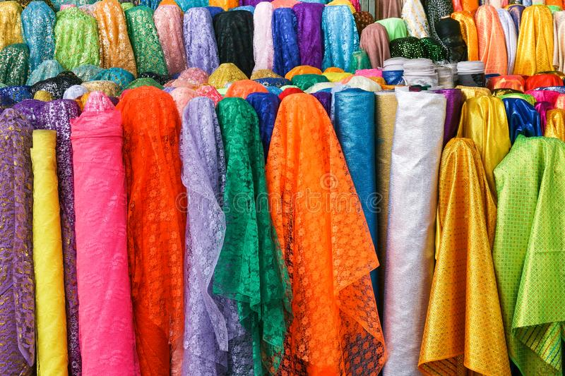 Rolls colorful of brightly coloured fabrics and cloths. Store royalty free stock image
