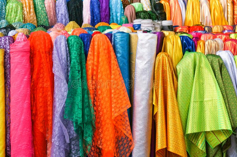 Rolls colorful of brightly coloured fabrics and cloths. Store royalty free stock photography