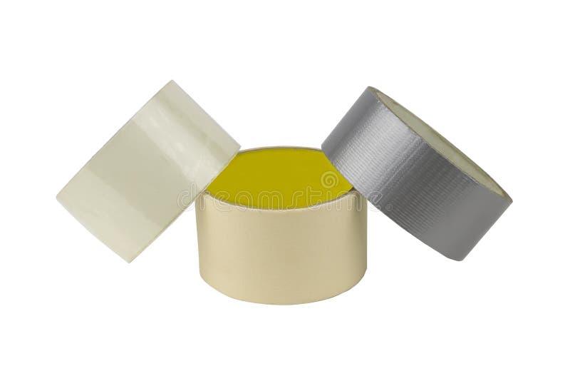Rolls da fita adesiva colorida no fundo branco imagem de stock