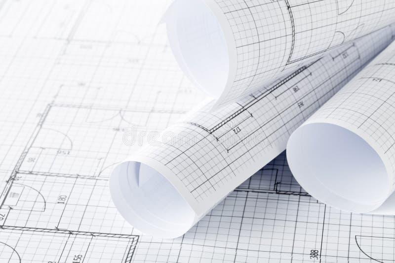 Rolls de los planes arquitectónicos de la construcción de viviendas del modelo en fondo del modelo fotos de archivo libres de regalías