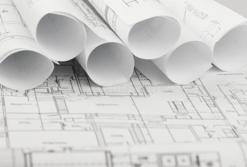 Rolls de los planes de los modelos y de la casa de la arquitectura imagenes de archivo