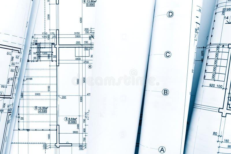 Rolls des plans architecturaux et de la construction de modèle techniques photographie stock