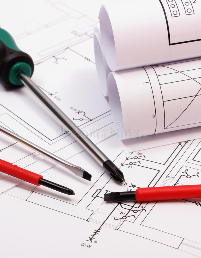 download rolls of diagrams and work tools on electrical construction drawing of house stock image