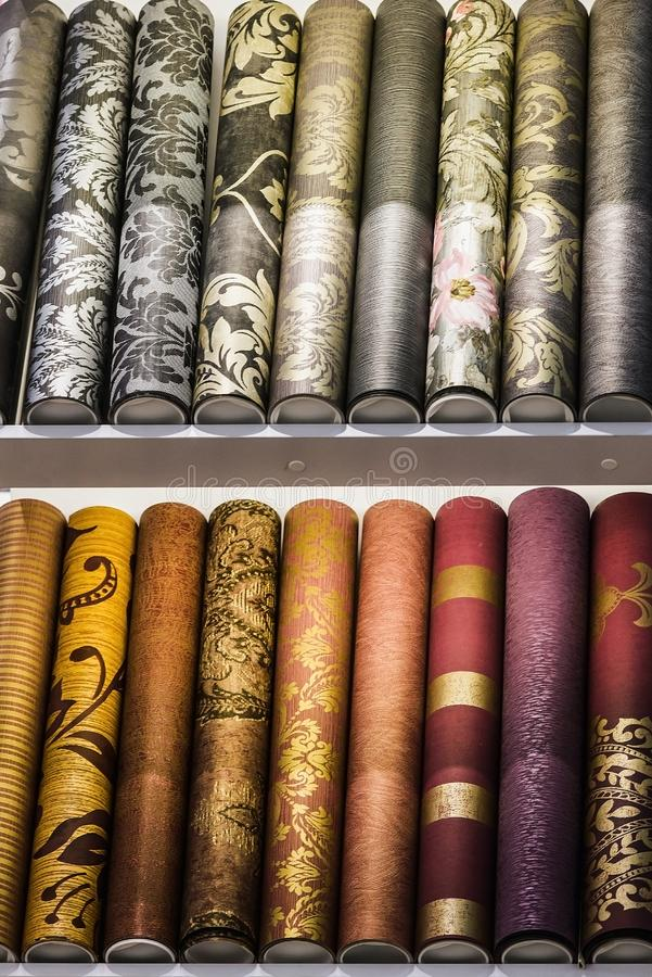 Rolls of different kinds of wallpaper royalty free stock image