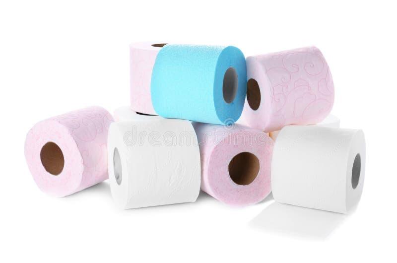 Rolls do papel higiênico no fundo branco imagem de stock