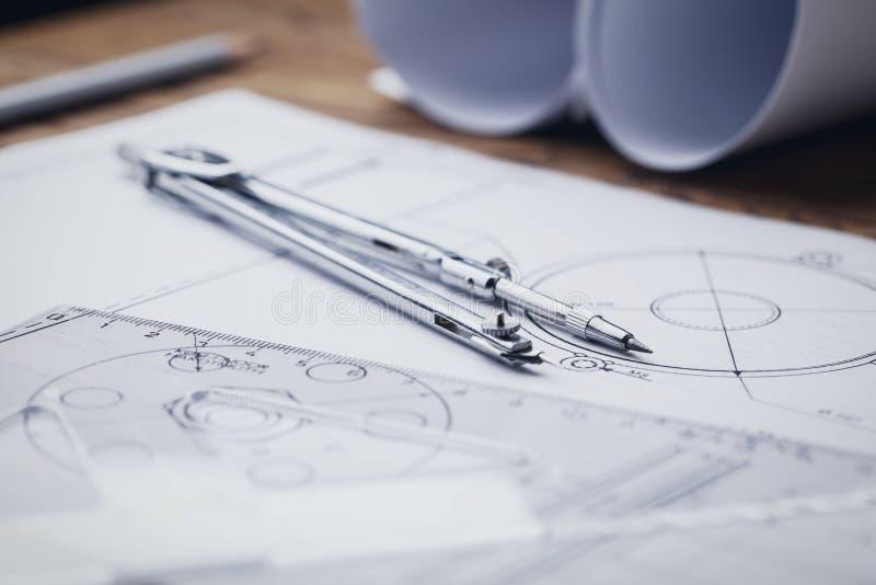 Rolls dos modelos, do compasso de desenho e de arquitetónico gráfico imagens de stock