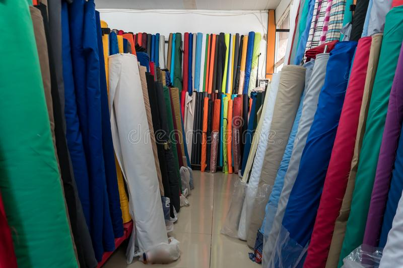Rolls of fabric and textiles in an eastern textile shop. Multi different colors royalty free stock image