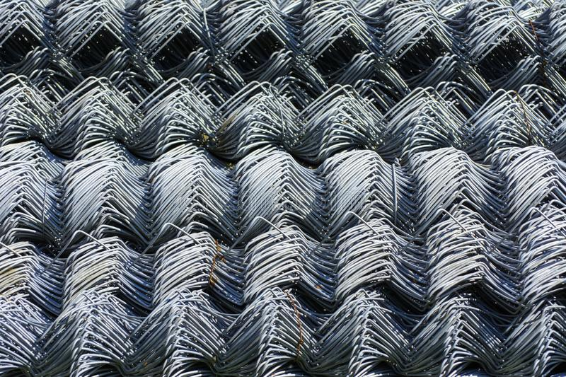 Rolls of galvanized steel wire mesh with a large cell and twisted pattern close-up. In the category of texture, screen. Saver, wallpaper royalty free stock image