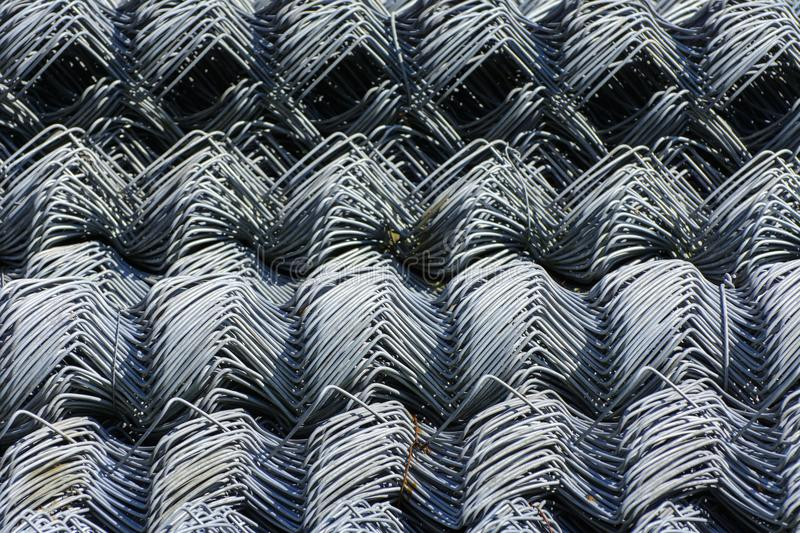 Rolls of galvanized steel wire mesh with a large cell and twisted pattern close-up. In the category of texture, screen. Saver, wallpaper stock photos