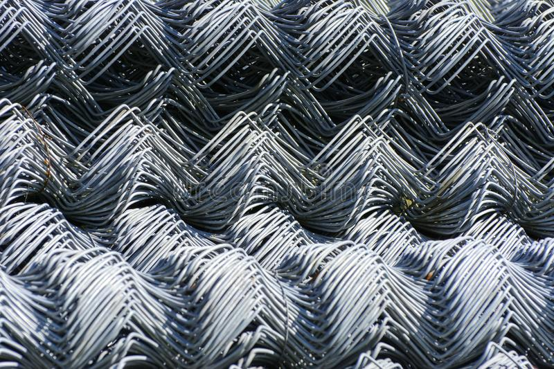 Rolls of galvanized steel wire mesh with a large cell and twisted pattern close-up. In the category of texture, screen. Saver, wallpaper royalty free stock photo