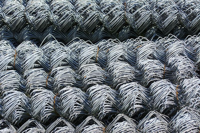 Rolls of galvanized steel wire mesh with a large cell and twisted pattern close-up. In the category of texture, screen. Saver, wallpaper stock photo