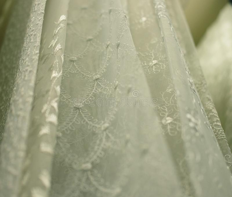 Rolls lace of pastel shades in a fabric store. Textile. Fashion background stock images