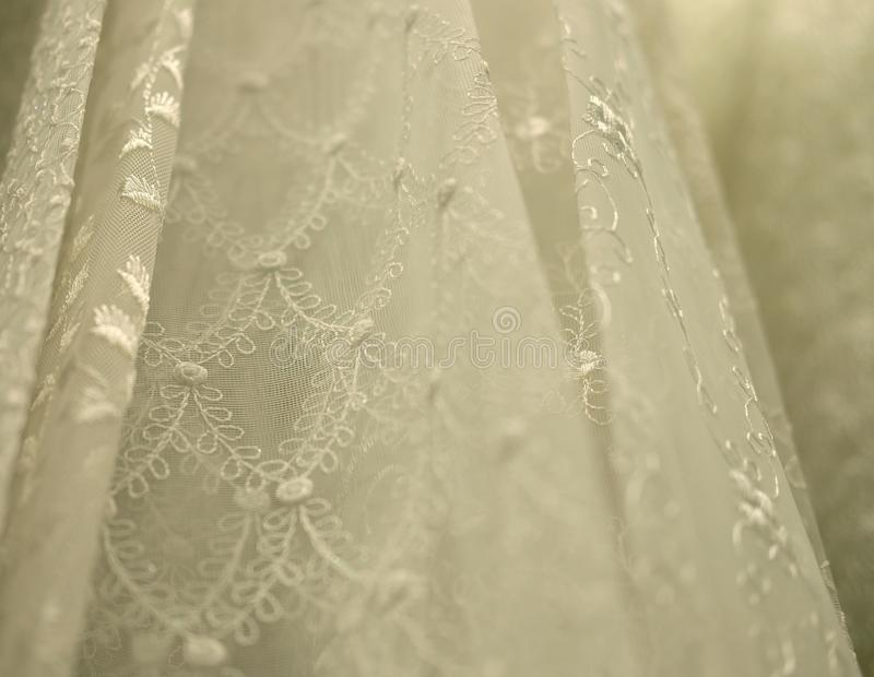 Rolls lace of pastel shades in a fabric store. Textile. Fashion background royalty free stock photo