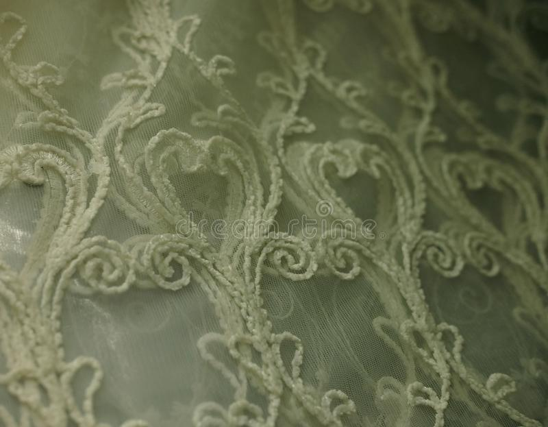 Rolls lace of pastel shades in a fabric store. Textile. Fashion background royalty free stock photos