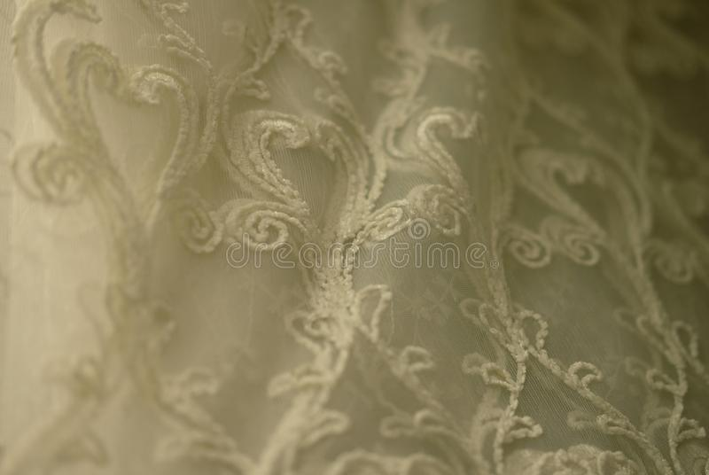 Rolls lace of pastel shades in a fabric store. Textile. Fashion background stock photography