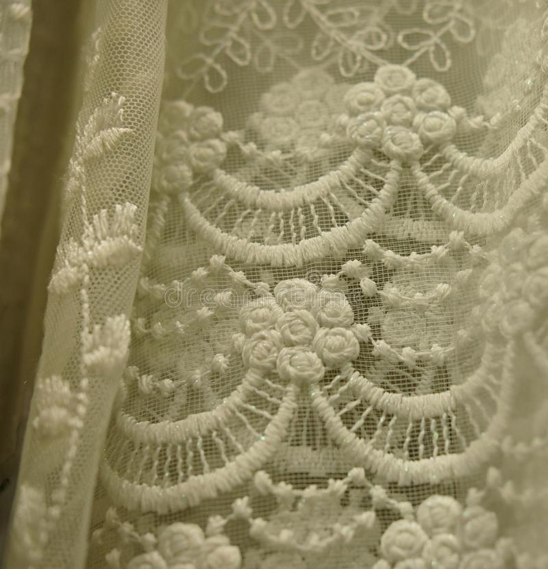 Rolls lace of pastel shades in a fabric store. Textile. Fashion background stock photos