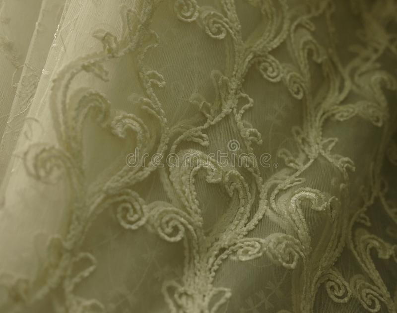 Rolls lace of pastel shades in a fabric store. Textile. Fashion background royalty free stock image
