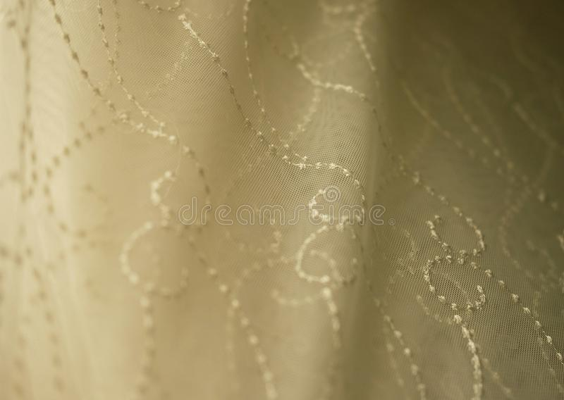 Rolls lace of pastel shades in a fabric store. Textile. Fashion background stock photo