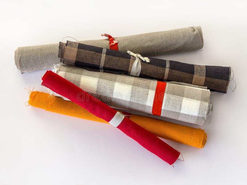 Rolls of linen cloth. Small rolls of linen cloth . Various linen fabric textile rolls stock photography