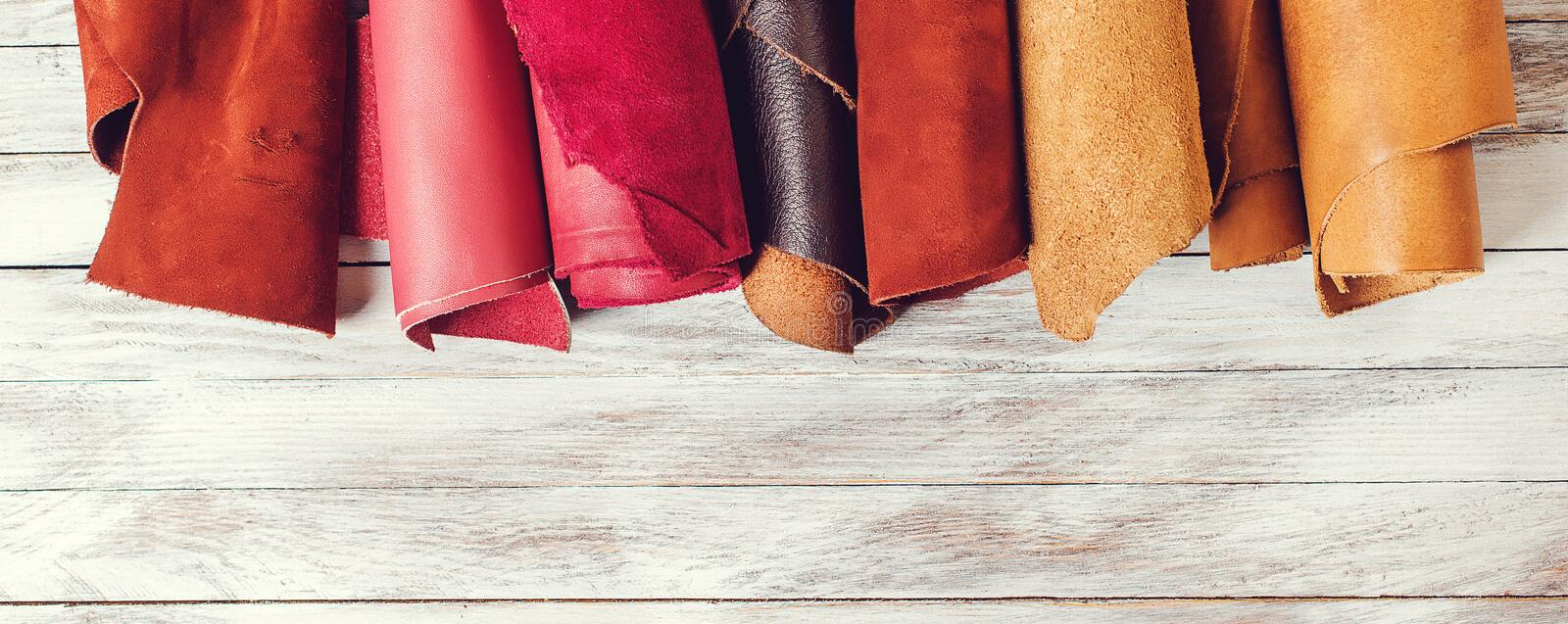 Rolls of natural color leather. Materials for leather craft. Copy space. Multi colored leather in rolls. Top view. Handmade craft. royalty free stock photos
