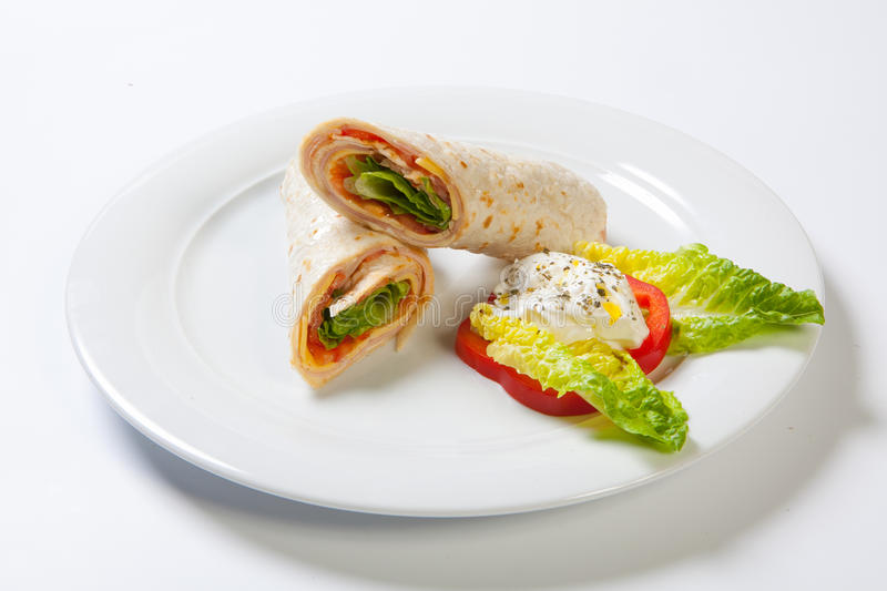 Rolls from pita bread stuffed with salad cheese ham and vegetables stock photo